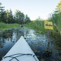 The Ludington Canoe Trail is marked by bright yellow signs.- Paddler's Guide to Ludington, Michigan