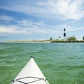 Nearing the Big Sable Point Lighthouse while paddling on Lake Michigan.- Paddler's Guide to Ludington, Michigan