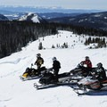 Snowmobile to great heights for far-reaching views of the Centennial, Gallatin, and Madison Ranges. Photo courtesy of West Yellowstone.- 3-Day Winter Adventure Itinerary for West Yellowstone