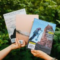 Last three issues of Misadventures. Photo by Alex Blackwelder.- Woman In The Wild: Sarah Connette