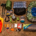 Backpack, tent, water filter, food items, sleeping bag, pillow, sleeping pad, hammock, poles, emergency items, head lamp, and stuff sacks.- Backpacking Essentials For Beginners