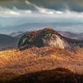 The view of Looking Glass Rock from the Blue Ridge Parkway is just one of many spots to take in all the beauty of autumn in the Appalachians. - A Guide to Leaf-peeping Weekends in the Blue Ridge Mountains