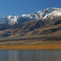 A snow-dusted Steens Mountain over Mann Lake. - 7 Great Reasons to Go Outside in the Fall, Part 5: Desert Visits