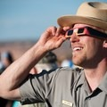 Don't forget your special shades! Photo by Neal Herbert. Published without modification under CC 2.0.- Photographing the Solar Eclipse