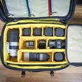 The dividers are adjustable, allowing you to customize your case. It also holds a surprisingly good amount of gear.- Gear Review: Mountainsmith Boarding Pass FX