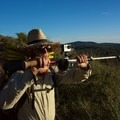 Only the Essential filmmaker Casey Gannon shooting with a GoPro mounted onto a trekking pole.- Only The Essential: The Adventure Behind the Lens