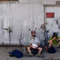 Thru-hikers rest for lunch in the shade of a utility building near Truckee California.- Only The Essential: The Adventure Behind the Lens