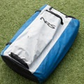The Big Earl comes rolled up in a breathable bag.- Gear Review: NRS Big Earl Stand-up Paddleboard