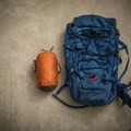 Bothy in its stuff sack next to my usual daypack.- Gear Review: Rab Superlite Shelter 4