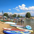 Demo boats and boards lined the beach at the Huntsville Reservoir.- Outdoor Retailer Summer Market 2016 Recap
