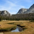 Following the stream through the meadows, Tuolumne Meadows to Yosemite Valley.- 3 Must-do Backpacking Trips in the Sierra