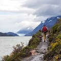 Hiking over Lago Grey with Grey Glacier in the distance.- 25 Photos That Will Make You Want to Adventure in Patagonia