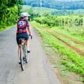 Riding past orchards outside of Charlottesville, Virginia. - Woman In The Wild: Sarah Connette