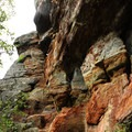 The route passes sheer rock faces.- Exploring Chimney Mountain in the Adirondacks