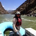 Sirena driving the boat for Arizona River Runners. Photo by Joe Pollack.- Woman In The Wild: Sirena Rana Dufault