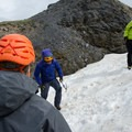 If you look at the fellow in green, you can see that the curvature makes step chopping a little more awkward.- Gear Review: Petzl Summit Ice Axe