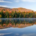 Fall reflections in New York's Adirondacks.- 15 Stunning Photos of Autumn in the Adirondacks