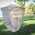 We've found the best way to assemble the Treepod Cabana is to suspend it, then install the arcing poles. This image shows the roof poles in place, but the floor poles are not installed in this photo.- Gear Review: Treepod 6-foot Cabana
