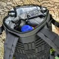 The back fabric is made with recycled plastic.- Gear Review: Ethnotek Premji 20-Liter Travel Daypack