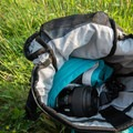 The main compartment with a raincoat and camera lenses.- Gear Review: Ethnotek Premji 20-Liter Travel Daypack