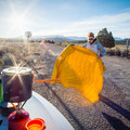 Knocking the dirt off the blanket on some backroad in Utah while waiting for coffee to be made.- Gear Review: Rumpl Original Puffy Blanket