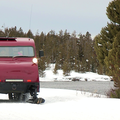 Snowcoaches offer a comfortable and warm travel alternative in Yellowstone's majestic winter splendor. Photo courtesy of West Yellowstone.- 3-Day Winter Adventure Itinerary for West Yellowstone
