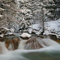 Snow can turn almost any sized waterfall into a beauty.- How to Photograph Waterfalls