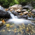 Don't be afraid to get wet to get the best angle.- How to Photograph Waterfalls