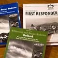 Wilderness First Responder coursebooks, well used after just the five days of classroom study.- My Experience Becoming a Wilderness First Responder